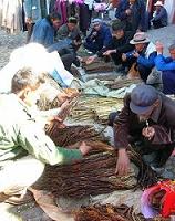Vendiendo producto en la feria del campo en China denominada Ganji