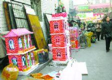 Maquetas de papel para ser quemadas frente a las tumbas en China